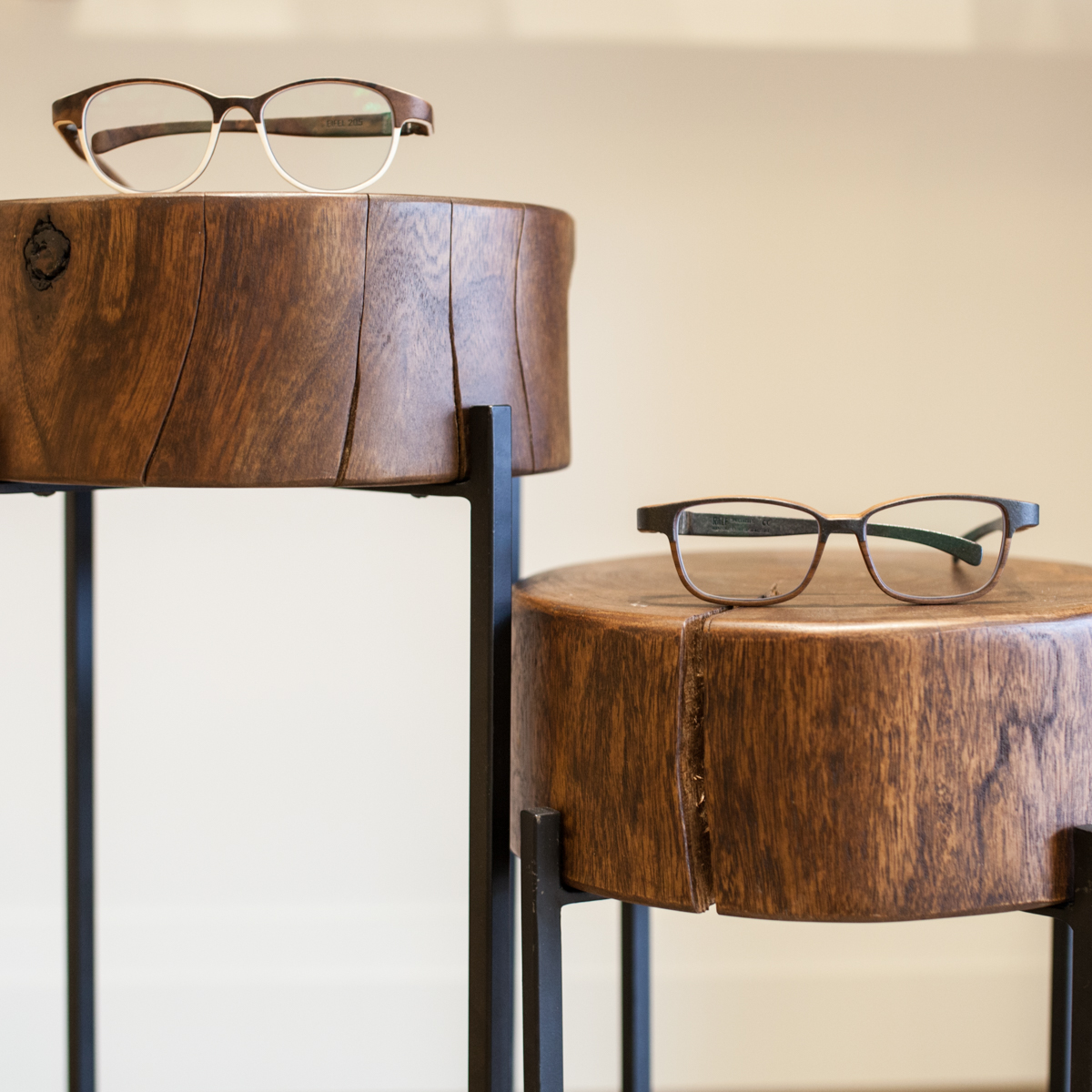 Frames from Rolf Spectacles (L-R) Eifel and Tickford, placed on Roost End Tables, hand made in India from Acai wood