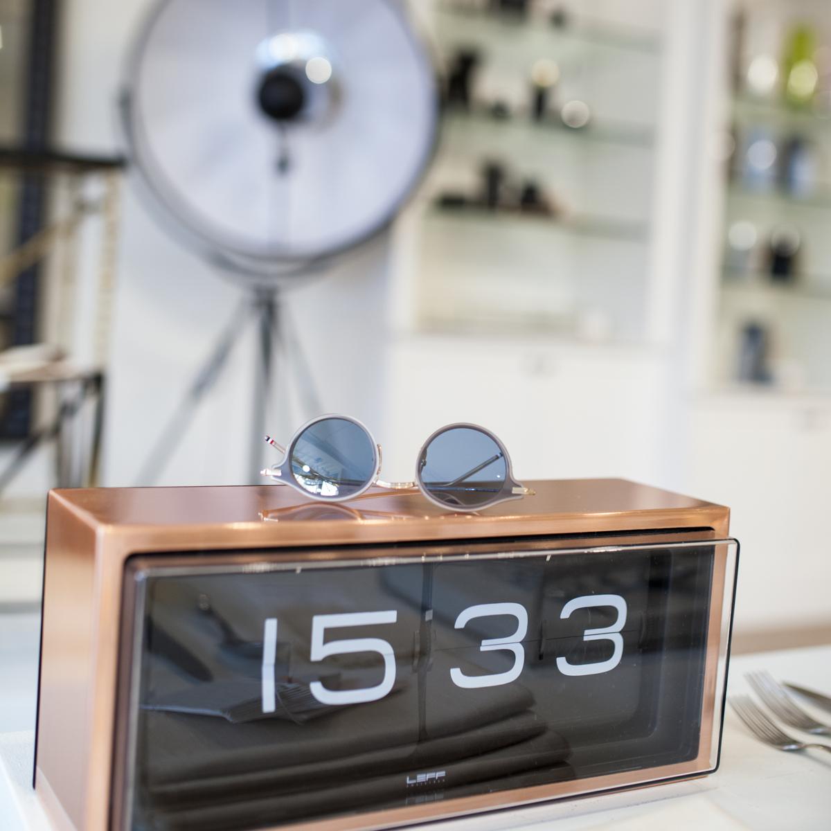 Thom Browne Sunglass TB-807 on top of a Leff Amsterdam Brick Clock in copper.